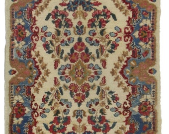2 x 4, Beautiful Persian Kerman rug. This piece is composed of hand knotted wool and features geometric designs throughout.