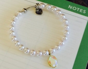 Pink pearl with antiqued gem