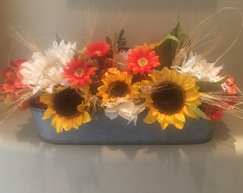 Beautiful centerpiece in tin container