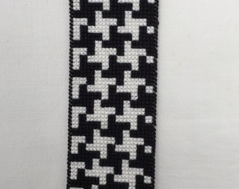 Plastic canvas bookmark, black & white houndstooth pattern, backed with red felt.