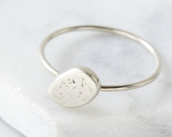 silver stacking ring with flecked pebble detail