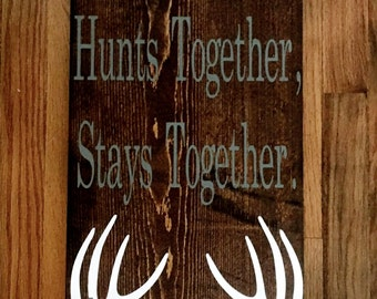 A Family That Hunts Together Wood Sign