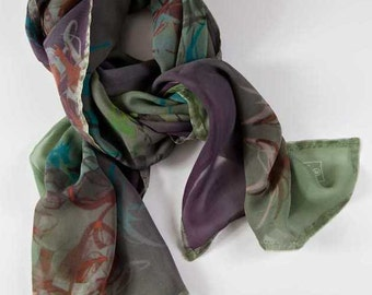 A lightweight silk chiffon long scarf.