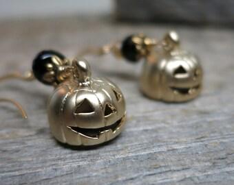 All Hallow's Eve earrings ... matte gold jack o lanterns / black onyx / orange hessonite