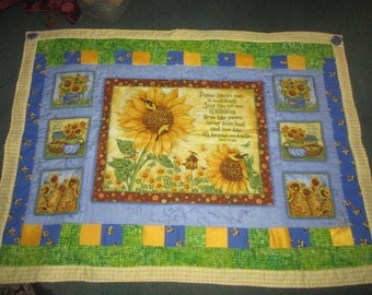 Blue and yellow sunflower lao quilt with green fleece backing and pinwheel embellishments