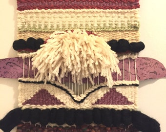 Weaving wall hanging deep red dusty plum with black accents