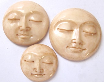 MS Carved Bone Tea Stained Round Moon Faces Closed Eyes Fair Trade Bali