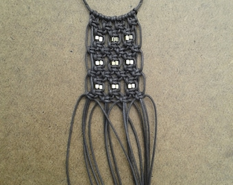 Brown macrame fringe necklace with gold beaded accents
