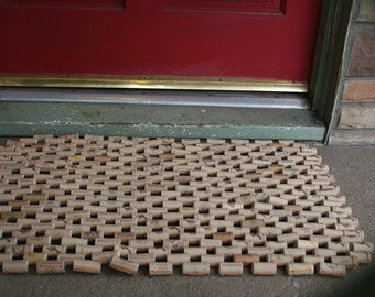 Synthetic cork doormat