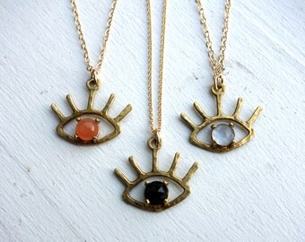 The Beholder - Brass and Onyx / Moonstone / Chalcedony Cabochon - Eye Pendant - Blink Necklace - Eye Lashes