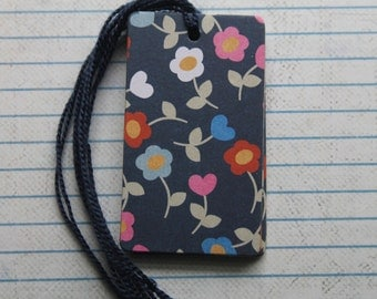 28 pretty pink, white, red flowers on navy blue paper over chipboard gift tags