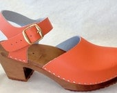 Soft orange Medium Heel Mary Jane w/ a buckled ankle strap
