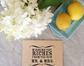 Wishing you riches from the new mr and mrs stamp, wedding stamp