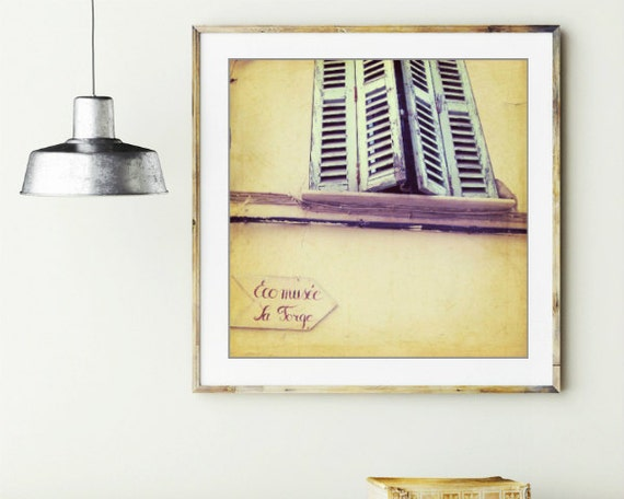 Provence France pale yellow wall art wood window shutters french writing  'Eco musee'