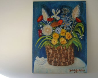vintage painting of a basket of flowers with a very nice cherub figurine and that blue we love in the background