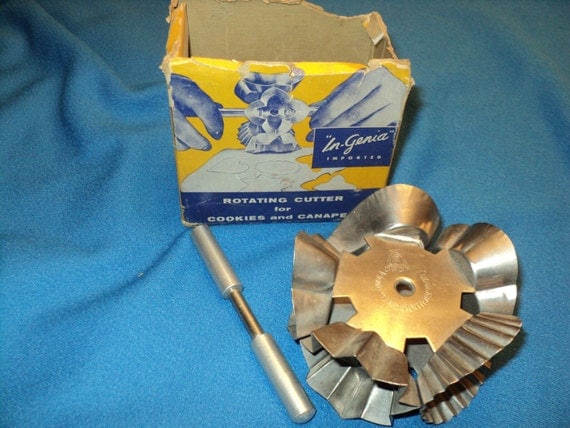 Vintage rotating cutter for cookies and canapes for Mini canape cutters