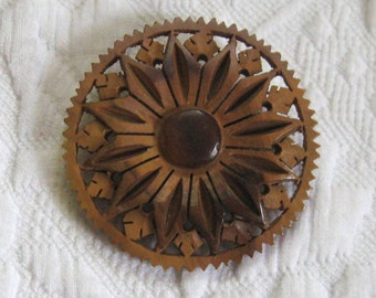 carved wood brooch . carved sandalwood brooch . hand carved brooch