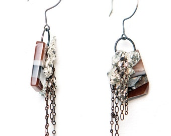Chained Slice dangle earrings.