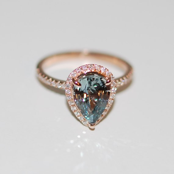 rose gold engagement ring teal blue green sapphire pear cut