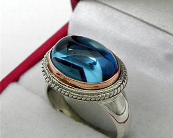 AAA London Blue Topaz Cabochon   14x10mm  8.24 Carats   in 18K Rose gold and Sterling silver ring.  1560
