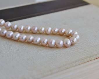 Freshwater Pearl Pink Champagne Oval Round 8.5mm 25 beads 1/2 strand