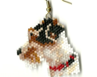 a sweet little pair of hand beaded Jack Russell dog head dangle earrings