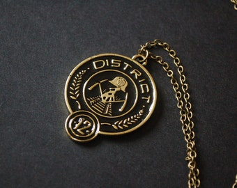 The Hunger Games district 12 coin necklace