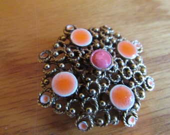 elegant pink and gold brooch