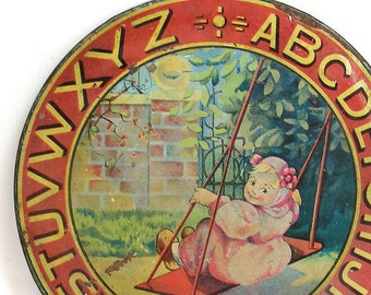 1920s Tin Litho Toy Tea Plate, Girl on a Swing, by Ohio Art Co. Large size. Shabby chic.