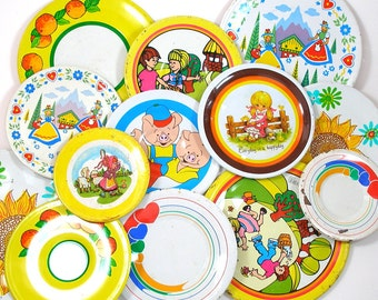 13 Tin Toy tea saucers in yellows, 1960s graphics, Instant Collection.