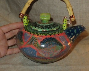 Teapot with vivid colors  great fish