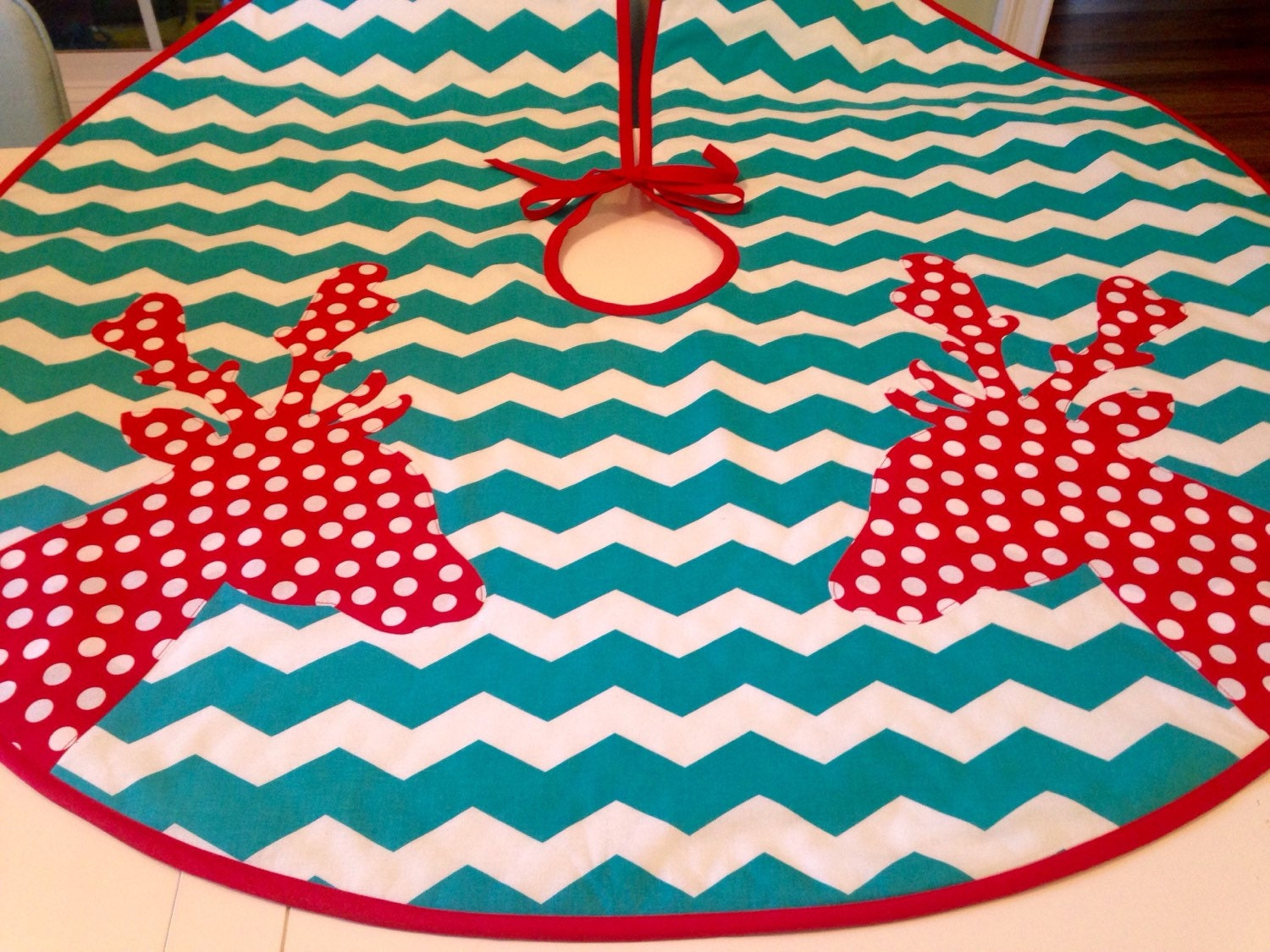 Modern tree skirt with red polka dot deer on teal and white