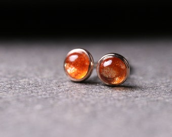 3mm natural Oregon sunstone set in solid 18k yellow gold with sterling silver posts and backs