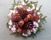 Pinecones, Babies Breath and evergreens corsage or pin for your holiday events.