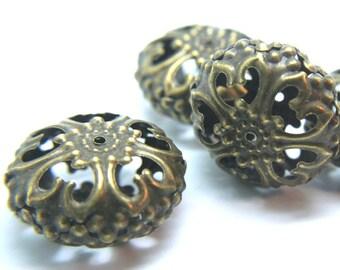 Antiqued vintage plated bronze filigree large beads. Old World Bronze color