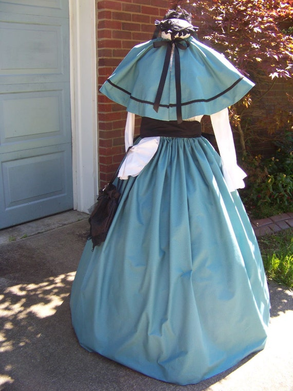 Victorian Costume Dresses & Skirts for Sale Dickens Victorian Outfit Long drawstring Skirt and cape Teal cotton small print with black Sash matching braid one size fit all $119.99 AT vintagedancer.com