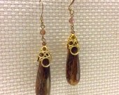 Tigers eye faceted drop dangle earrings gold caps.