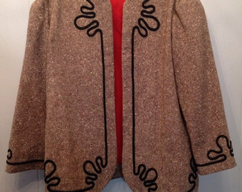 1970's tweed jacket with burnt orange lining and dark brown trim. Inside pocket.