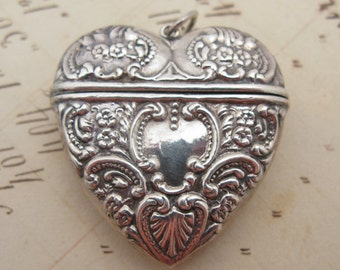 Antique Sterling Silver Repousse Heart Locket