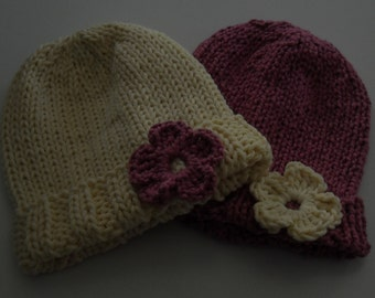 Set of Two Newborn Knitted Baby Hat with Crocheted Flower in Cream and Violet Pink