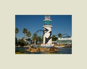 SeaWorld Entrance with Roller Coaster in the Background 5x7 print with 8x10 mat