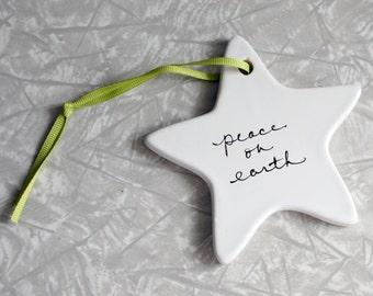 peace on earth ornament, ceramic ornament, handwritten, christmas ornament, white star ornament, cursive script, holiday