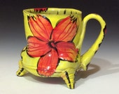 Yellow footed mug with red flower