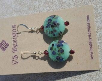 Soft aqua earrings with garnet accents