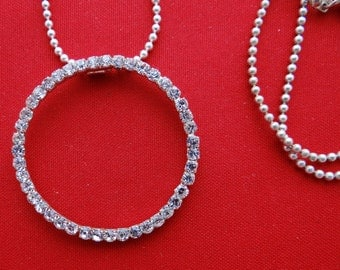 """Vintage 20""""  silver tone necklace with attached 2"""" rhinestone circle pendant in great condition, appears unworn"""