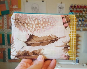 Scalloped feather pouch