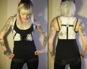 Kissin' Bombs vest with metal rings