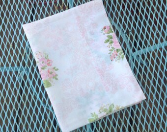 Vintage pink floral pillowcase.