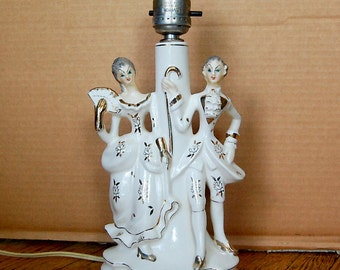 Vintage Colonial Boudoir Ceramic Lamp Figurines of Couple Gold and White Vampires.