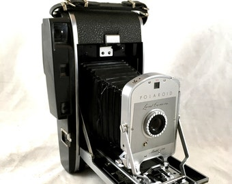 Polaroid Land Camera Model 150 Leather Carrying Case. Lots of Extras. Photoelectric Shutter, Wink Light Flash, Copy Lens, Filter, Brochures